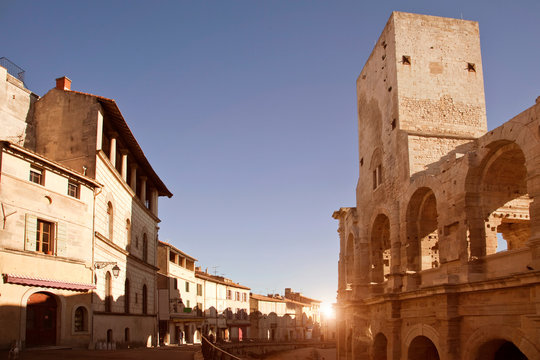 View of street and Arles Amphitheatre, Arles, Provence-Alpes-Cote d'Azur, France