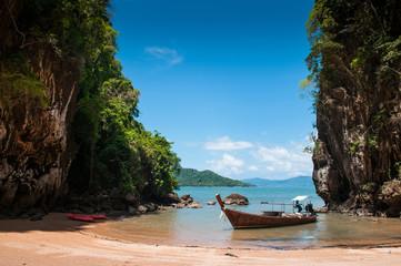 Kayak and longtail boat at beach of Koh Talabeng near Koh Lanta, Krabi, Thailand