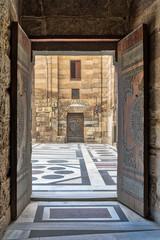 Opened door leading to the courtyard of Al-Sultan Al-Zahir Barquq mosque. Al-Moez Street, Old Cairo, Egypt