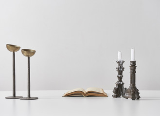 designed candlestick with book object
