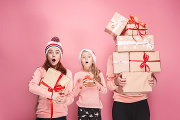 Father and mother give gifts to little daughter at studio