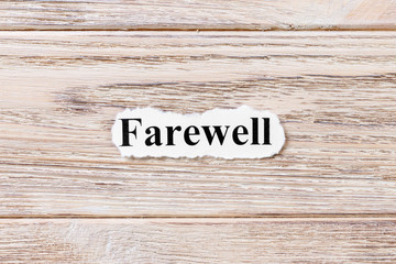 Farewell of the word on paper. concept. Words of Farewell on a wooden background