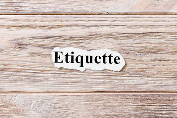 etiquette of the word on paper. concept. Words of etiquette on a wooden background