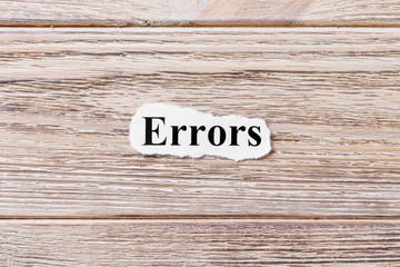Errors of the word on paper. concept. Words of Errors on a wooden background