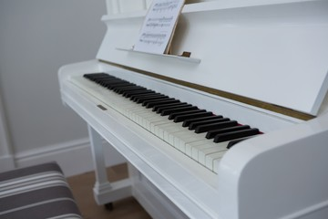 Close-up of musical sheet on piano