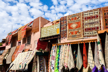 colorful carpets hanging at moroccan shops, marrakech