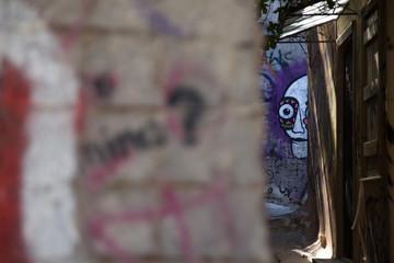 Graffiti in small street in Plaka, Athens