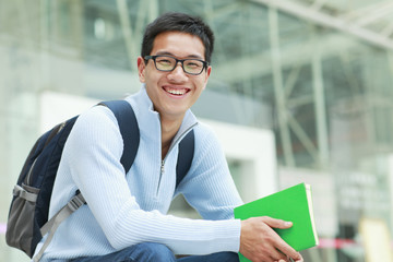 picture of one young asian male college student in campus