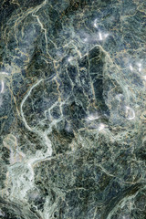 Green granite rock background texture close up