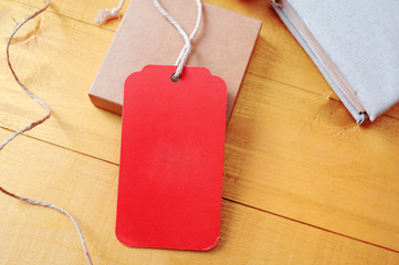 Large Price red Tag red tag on a golden wooden background