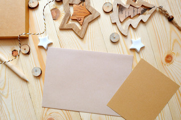 Christmas background kraft sheet of paper with place for your text and white christmas star and tree on wooden background. Flat lay, top view photo mockup