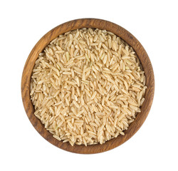 brown rice in a wooden bowl