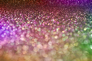 colorful pastel purple pink green bokeh light glitter background for Christmas and New Year's day
