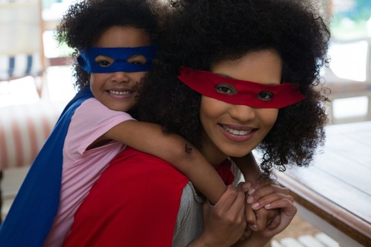 Mother and daughter pretending to be superhero
