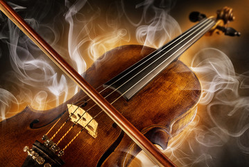 violin and surrounded by smoke
