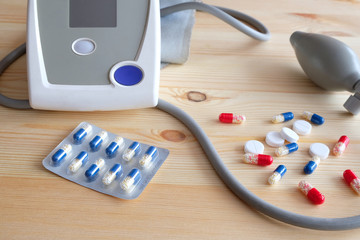 Pills and Tonometer on the table