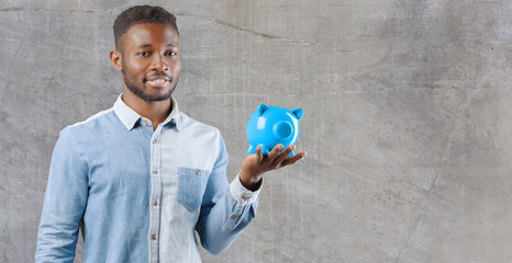 Black man with piggy bank