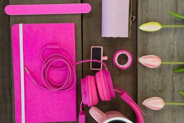 Overhead of female accessories and stationery