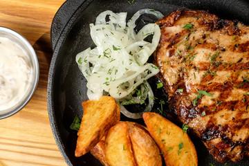 meat frying pan potatoes vegetables dish