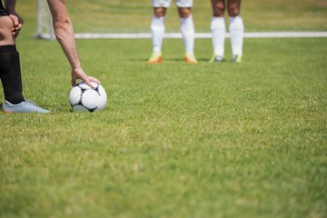 Soccer player is ready to kick ball from penalty spot