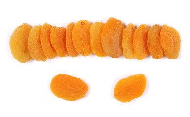 Dry apricots isolated on white background, top view