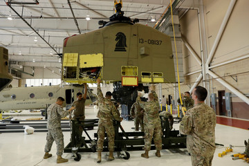 Soldiers from the 1st Armored Division, Combat Aviation Brigade, work to disassemble a CH-47 Chinook helicopter to ship to Puerto Rico in order to aid in recovery efforts following Hurricane Maria at Fort Bliss in El Paso