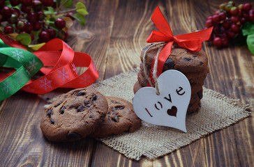 A small handmade gift. Homemade cookies and a heart. Family values.
