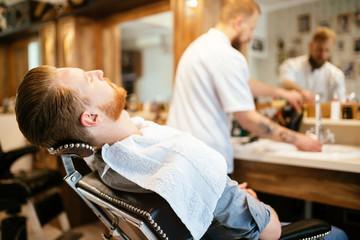 Male receiving hair beard treatment