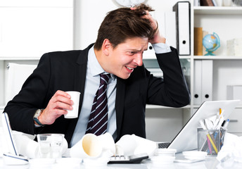 Man in stress sitting at the table