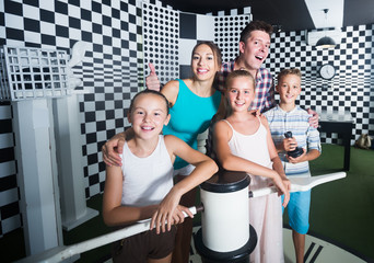 Smiling family is visiting of escaperoom