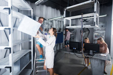 Parents with kids visiting room stylized under laboratory