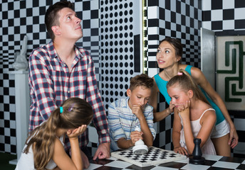 Young family is visiting of escape room