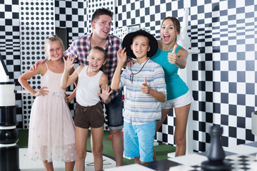 Portrait of family who is satisfied of visit of entertainment