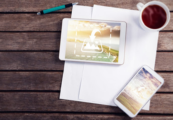Tablet and Smartphone on Wooden Table with Coffee and Stationery Mockup