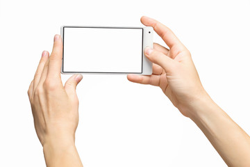 Mockup of female hands holding frameless cellphone with blank screen and making selfie at isolated background.