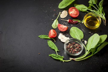 Tomatoes and bunch of fresh green basil on a dark wood background,