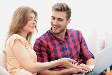 closeup of young couple with laptop
