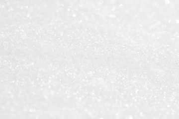 The background is white. The texture of the brilliant snow for the New Year's postcard. Wall mural