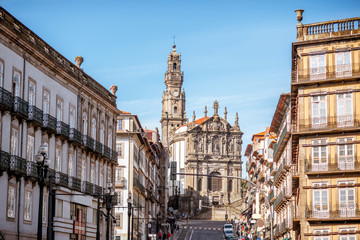 Street view with Clerics church during the sunny day in Porto city, Portugal