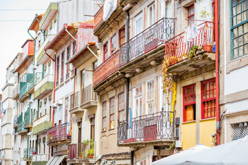 Street view on the beautiful old buildings with portuguese tiles on facades in Porto city, Portugal