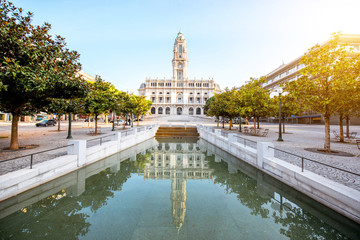 Morning view on the city hall building with reflection in the fountain on the central square in Porto city, Portugal