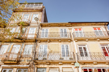 View on the beautiful old building facades with famous portuguese tiles on the street in the old town of Porto city, Portugal