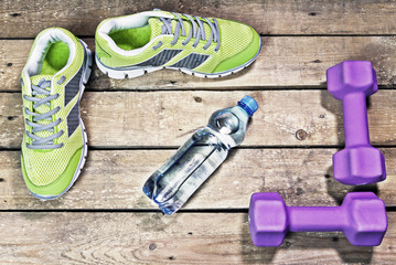Sports sneakers, dumbbells, drinking water on a wooden background, hdr,  flat lay