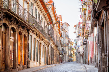 View on the narrow street with beautiful ancient buildings in Porto city, Portugal