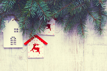 Christmas background. Christmas trees and Christmas decorations are on old light boards. Fir branches. Handmade decorations. Toned image. Space for text.