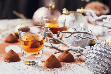 Whiskey or liqueur, truffle chocolate candies in cocoa powder an