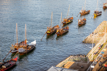 Top view on the old portuguese boats on the Douro river in Porto city, Portugal