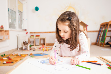 Drawing lesson in kindergarten