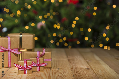 christmas gifts on table christmas tree background