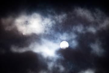 moon shining through clouds